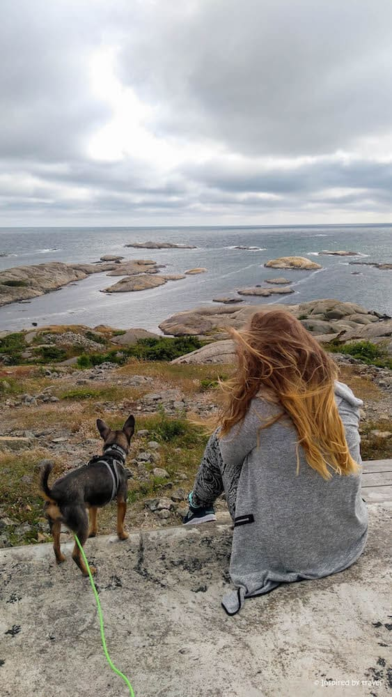 A girl and her dog in Verdens Ende, Norway.