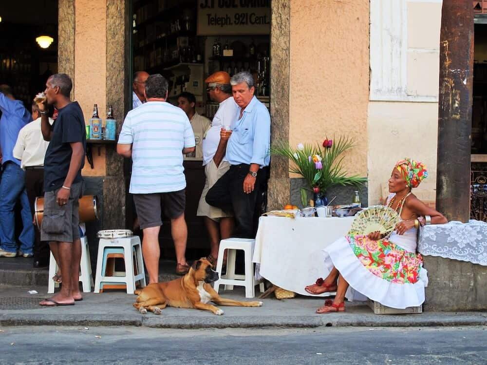 A dog outside of a restaurant in Rio de Janeiro.