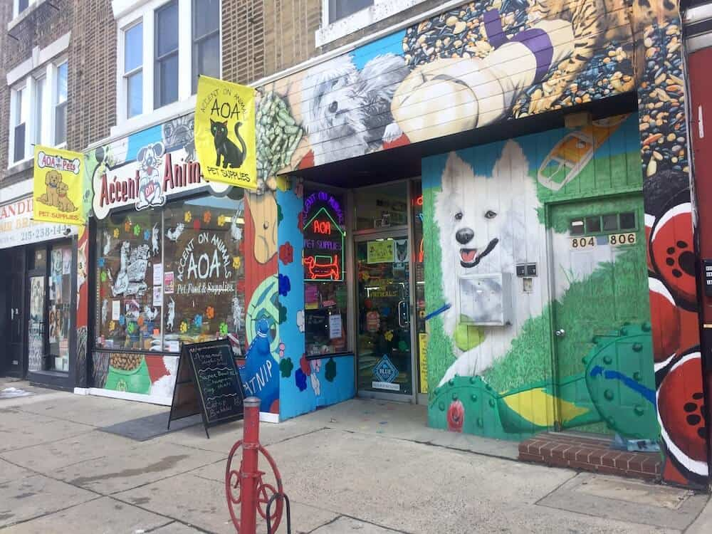The painted outside walls of a pet store in Philadelphia.