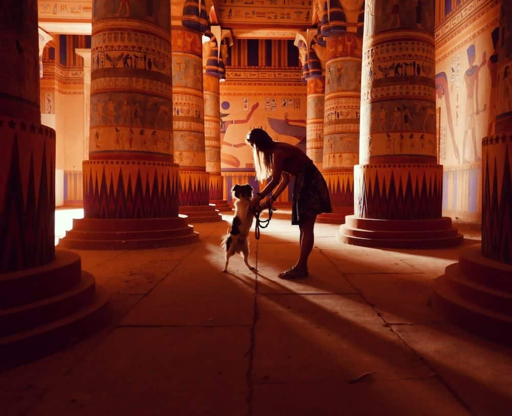 A woman dances with her dog in a Moroccan temple.