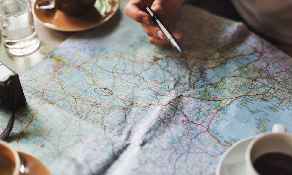 A person looks over a map, planning an adventure.
