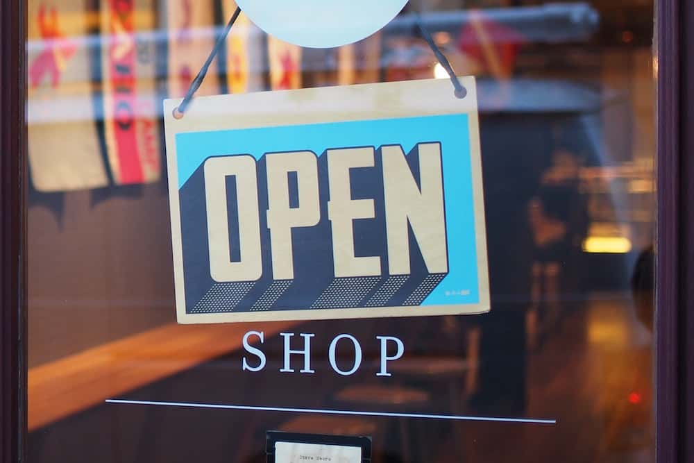 Open sign in front of a shop.