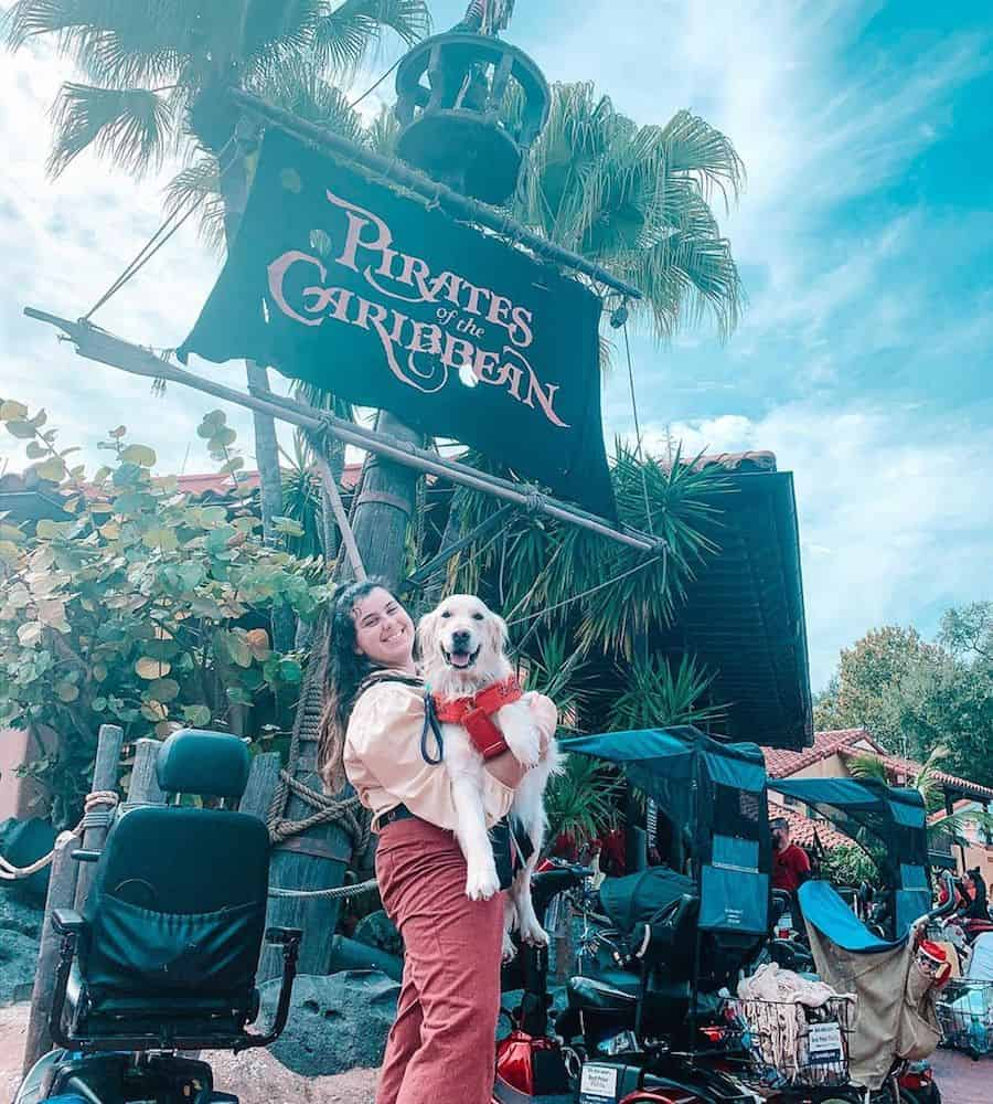 A Disney World employee and her service dog.