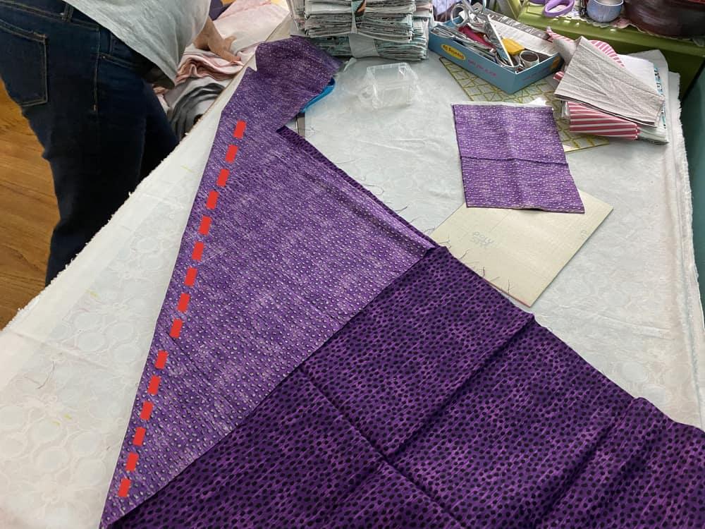 Preparing to cut fabric