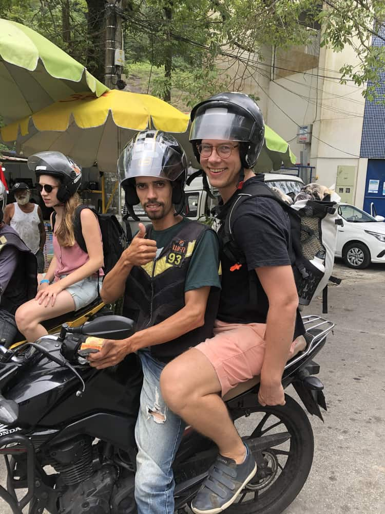 A moto-taxi going up Vidigal.