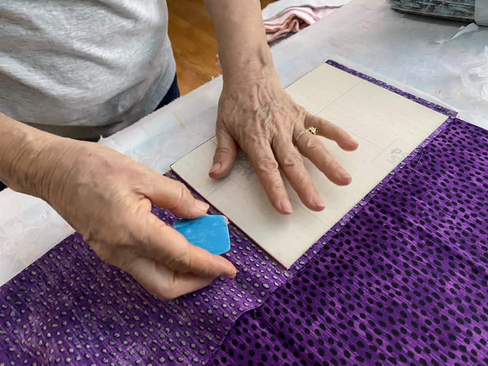 Marking a 9x6 rectangle on fabric.