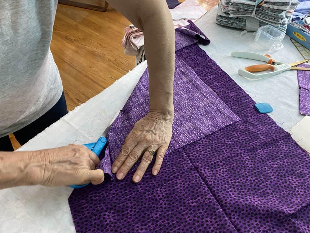 Cutting a piece of fabric.