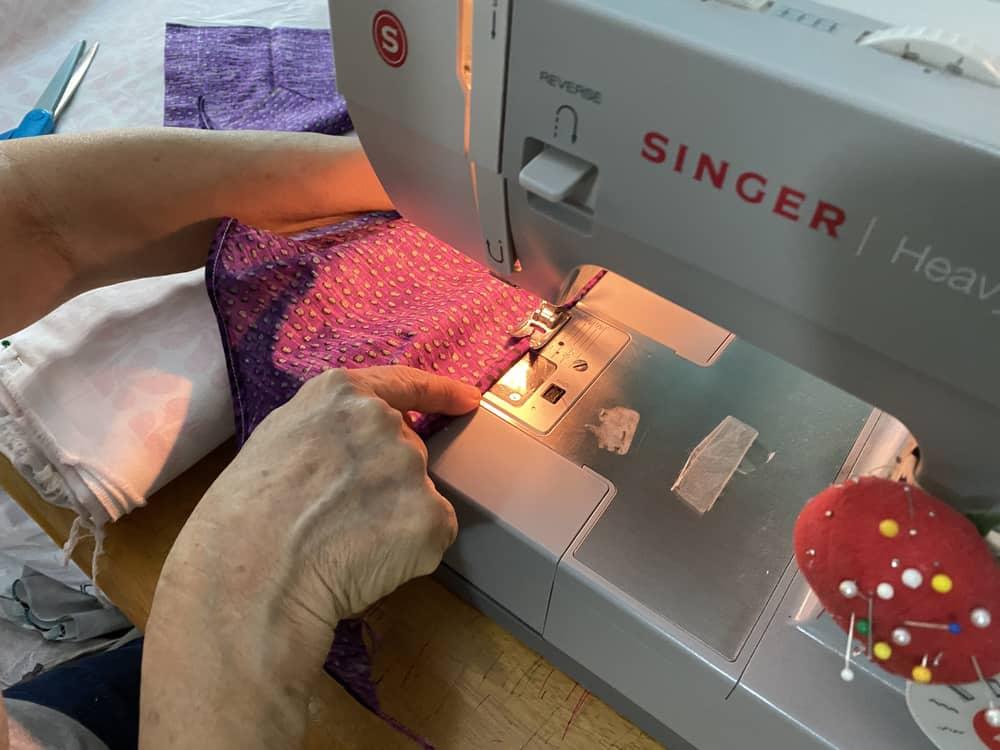Sewing a dog bandana.