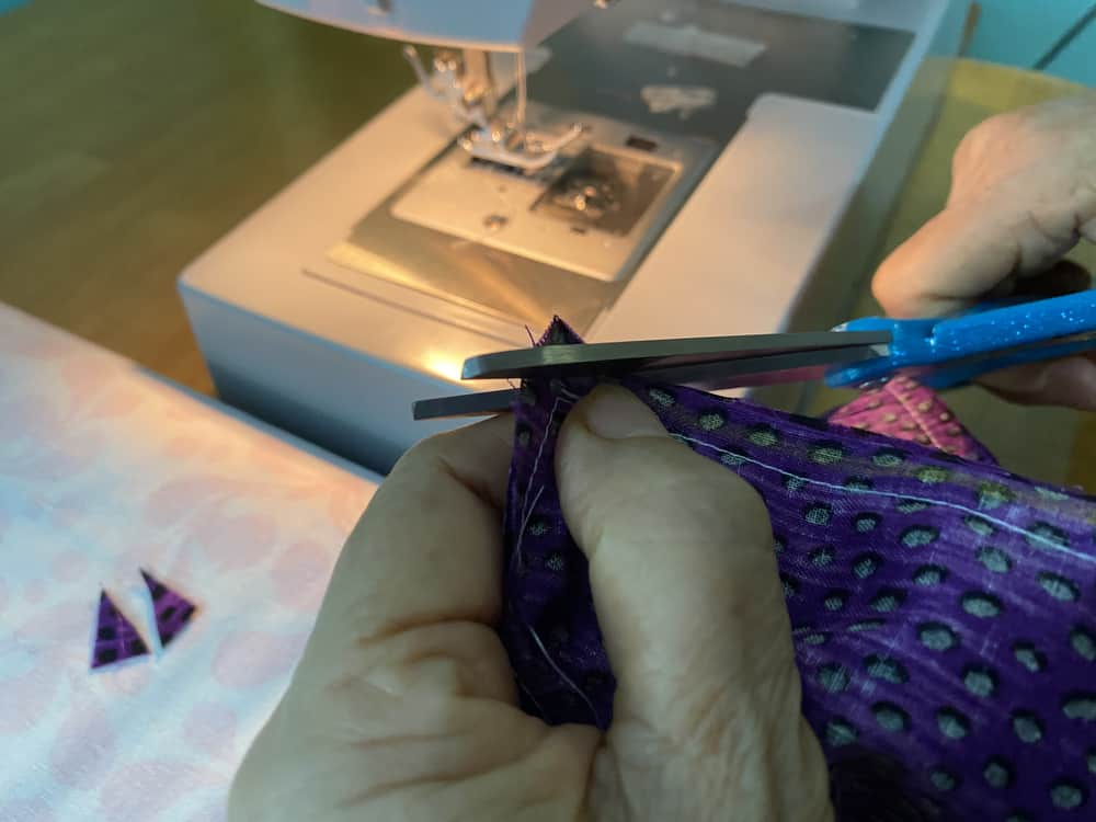 Cutting the corner of a piece of fabric.
