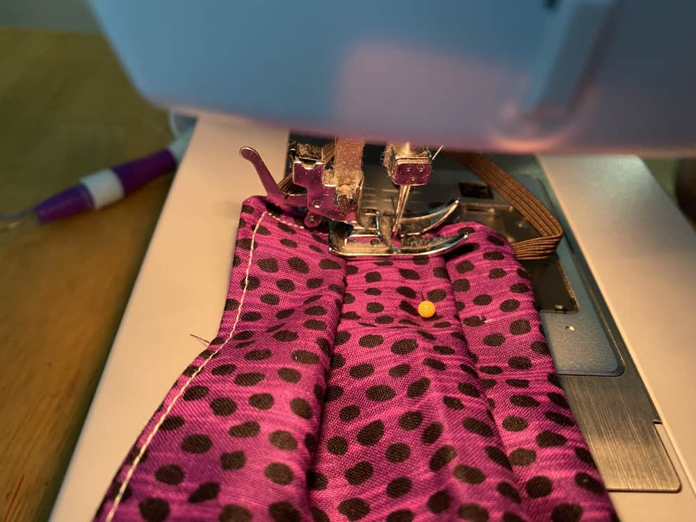 Sewing the folds down.
